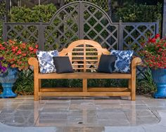 Every detail should be considered in your exterior living space. Everywhere you look it should look like a beautiful picture. This photo show custom iron work which compliment the furniture and gives privacy between the pool area and driveway. The pool deck is a very light tumble marble. The chaises and bench by Kingsley Bate.