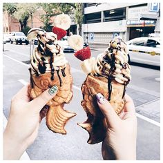 Welcome fish ice cream cones. They're little dough fish filled with soft serve ice cream, and they look adorable and delicious. Hooray for sundae in a fish.