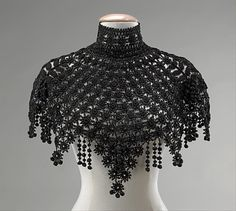 Pelerine Date: ca. 1890 Culture: American Medium: jet, silk Dimensions: Length at CB: 14 in. cm) Credit Line: Brooklyn Museum Costume Collection at The Metropolitan Museum of Art, Gift of the Brooklyn Museum, 2009 1890s Fashion, Victorian Fashion, Vintage Fashion, Col Crochet, Crochet Shawl, Beaded Crochet, Crochet Collar, Historical Costume, Historical Clothing