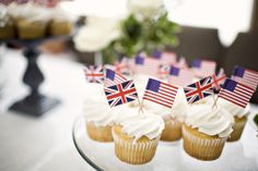 Cupcakes a couple had at their wedding. The groom was from GB and the bride from America, hence the little flags. So cute!
