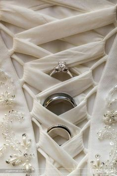 Wedding ring shot with the back of a wedding gown! Show off your wholesale diamonds on your special day! [ 1diamondsource.com ] #jewelry #diamond #quality