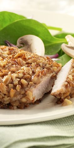 Thin cut pork chops are coated with mustard and enrobed in a toasted pecan-sunflower kernel mixture