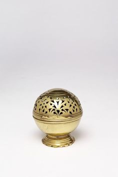 Soap container, England, Great Britain, ca. 1750, Brass, previously silvered and small traces remain. Soap containers sat on aristocratic dressing tables as part of toilet sets. Perforations in the box allowed the soap to dry. Companion pieces with solid tops kept sponges damp.Brass coated in silver was a relatively common silver substitute until the Sheffield plate industry was established in the mid-1740s. (c) VA