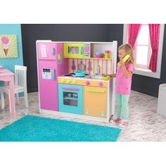 KidKraft - Deluxe Big and Bright Kitchen: Kids will feel just like mum and dad when they cook up fun with the Deluxe Big and Bright Kitchen. This wooden kitchen is cute, colorful and built to last. Removable sink for quick and easy cleaning.Knobs on the oven and sink that turn and click  Convenient storage above and below the sink. Large enough that multiple children can play at once.Dimesions: 107cm x 41cm x 109cm. #alltotstreasures #kidcraft #deluxebigandbrightkitchen #woodentoys…