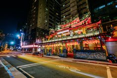 Passing By by tchebotarev  city night lights temple long exposure car trail Taiwan Taipei Asia 台北府城隍廟 Taipei Fu Cheng Huang Tem