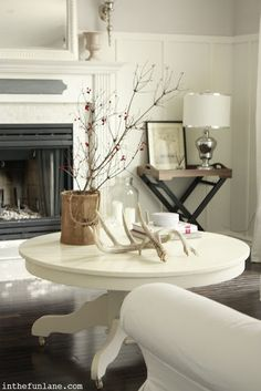 White Round Coffee Table paint your oak table with acrylic white. Add updated new upholstered chairs.