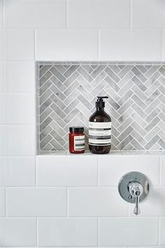 White subway tiles frame a gray marble herringbone tiled shower niche.Another niche idea. White subway tiles frame a gray marble herringbone tiled shower niche. Tiny House Bathroom, Bathroom Renos, Laundry In Bathroom, Bathroom Remodeling, Remodeling Ideas, Subway Tile Bathrooms, White Bathrooms, Bathroom Marble, Grey Grout Bathroom