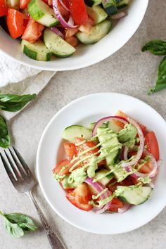 Recipe for quick and easy cucumber tomato salad. With fresh tomatoes, cucumbers and a creamy green goddess dressing lightened up with greek yogurt and avocado!
