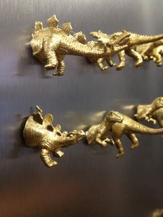 This order is for a toy vinyl dinosaur painted gold with a magnet attached. All are split in two halves. ***You get the head and tail as a