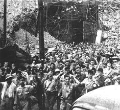 May 1942: After defending the island for nearly a month, American and Filipino soldiers surrender to Japanese invasion troops on Corregidor island, Philippines.