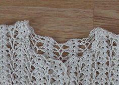 Crochet shell sweater.