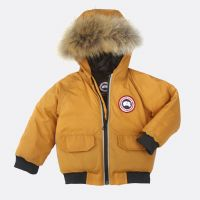 CANADA GOOSE BABY ELIJAH PARKA MAIZE  The Elijah Bomber is based on the classic Chilliwack Bomber; but with a removable fur ruff for easy cleaning and is what every young one needs to be as warm and fashionable #kidsouterwear