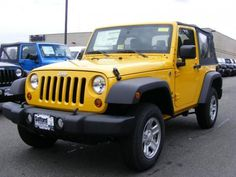 traded in our 2 door jeep wrangler for a new 4 door but boy do i miss my detonator yellow jeep!