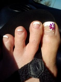 O P Nails - Lawton, OK, United States. French pedicure with flower design, first time visit, really happy!