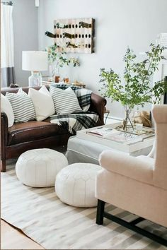 Cozy living room with white Moroccan poofs, a blush pink chair and a brown leather couch. Dark Leather Couches, Brown Leather Couch Living Room, Living Room Sofa, Home Living Room, Living Room Designs, Living Room Furniture, Rustic Furniture, Living Room Decor Dark Brown Couch, Antique Furniture