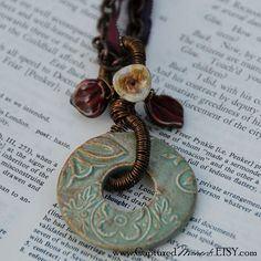 Washer necklace-I am thinking I could use a stamp and embossing powder to create this kind of raised embossing on a washer-then use paint, etc to create the porcelain appearance.