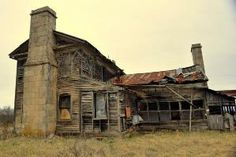 This abandoned house in the Missouri Ozarks is much bigger than the usual house.  May have been a hotel or a boarding house. by melanie
