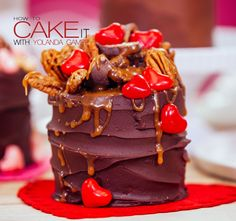 Ooooh yeah. You know I'm all about that ganache covered chocolate cake. Topped with cinnamon hearts, chocolates, and pecans. Drizzle the whole cake in caramel. Happy Valentine's Day! #Baking #Dessert