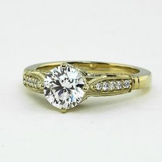 18K Yellow Gold Heirloom Diamond Ring, set with beyond conflict free 1.02ct. round diamond.