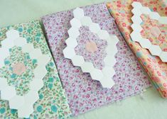 I like the idea of appliqueing the hexagon flowers onto a matching background -