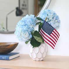 diyplaybookMy go-to trick to incorporate some red, white & blue indoors for both #memorialday & the 4th of July is adding a 99 cent #flag into any floral arrangement. It's quick, easy and such an affordable trick for entertaining. If you are hosting a #BBQ tonight or tomorrow, grab a flag at the grocery store when you pick up your flowers and you are good to go!!