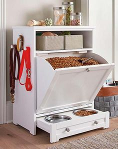 Enjoy the convenience of food leash and toy storage plus a feeding station all in one stylish compact space with our Pet Feeder Genius Solutions for Your Pets in the Kitchen Animal bones and scrap meat or fat may be used to make an extreme Diy Casa, Dog Rooms, Pet Feeder, Dog Houses, Home Organization, Pantry Organisation, Diy Furniture, Dog Crate Furniture, Furniture Storage