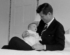 Proud dad with Caroline.  Despite his alleged indiscretions, there is no doubt in my mind that he was totally in love with Jackie and was a fantastic, loving and devoted father.