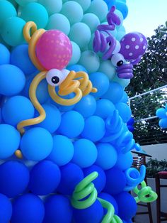 Sea theme party balloon decoration, octopus balloon sculpture, underwater theme balloon decor, column wrapping with balloons, outdoor balloon decoration.  OR Even just fabric backdrop with fun critters!