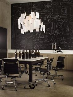 Eames Aluminium Chairs, chalkboard, Ingo Maurer and some wine. Nice.