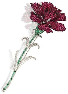 Red carnation brooch by Michele della Valle, set with white diamonds and 2.97 carats of round spinels. The lovely green stem is detailed in cabochon green tourmaline segments. The brooch set in white gold and titanium.