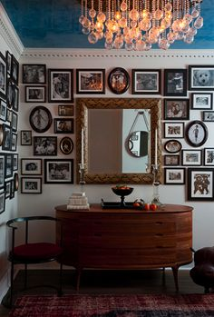 fun chandelier & funky desk, but LOVE well done wall/walls of photos!!!