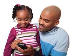 Father helps daughter with mobile phone