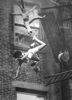 Fire at Marlborough Street, 1975 by Stanley J. Forman || Real photo. Fall from the fifth floor - younger girl survived. Author won a Pulitzer Prize for this photograph in 1976.