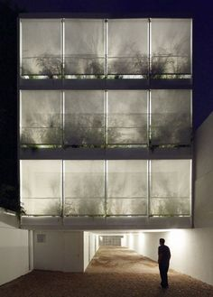Beautiful apartments with recessed balconies filled with plants!    Once Building by Adamo-Faiden