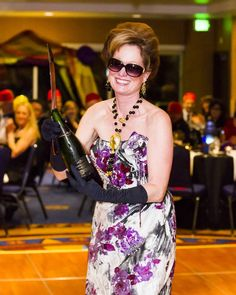 Master Sommelier Catherine Fallis sabers a bottle of Moet Imperiale for the Alain Pinel Group Wine Reviews, Champagne, Group, Bottle, Women, Flask, Jars, Woman
