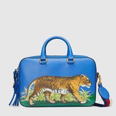 1ac8195e215 2100 Gucci Tiger print leather top handle bag Sac Boston