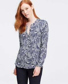 Flaunting a mod split neck and high low hem, this gorgeously patterned blouse channels a look of laid-back luxe. Add a cami beneath for more coverage. Split neck with pleated neckband. Long sleeves with button closure. Button front. Back yoke. Hi-lo shirttail hem.