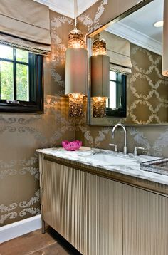 ...love that pendant & loving the wallpaper. Just a really chic powder bath.