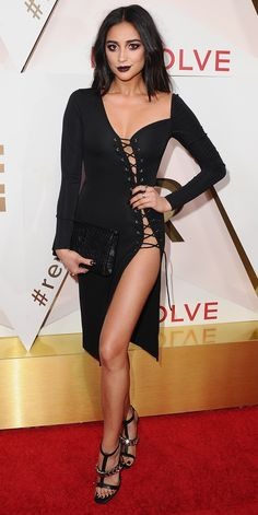 Chrissy Teigen Flaunts Major Cleavage inDaring High-SlitGown at the Revolve Awards - Shay Mitchell from InStyle.com