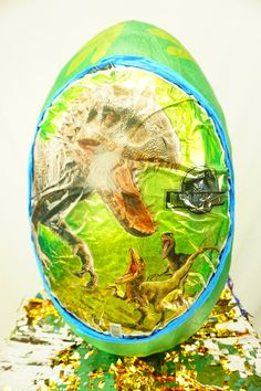 Check out our Jurrasic Park Surprise Egg or order something custom. Let us know :) They are like the New Pinatas but these Surprise eggs are usually filled with Toys instead of Candy. Order your Surprise egg now and fill it up with awesome prizes to bring smiles into the world! Formed with carefully measured and cut cardboard strips to make an egg shape, and reinforced with paper mache. Opening is cut in the back to fill and retrieve prizes. Can be reusable