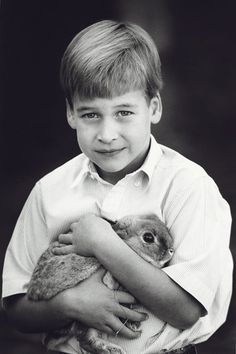 Prince William back in 1989 posing with a rabbit (Vogue)