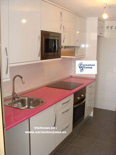 """Muebles de cocina a medida en color blanco alto brillo con encimera de formica en color trend rosa.Electrodomesticos de la firma Teka.Visitenos en: ww.exclusivasjoma.es — con Exclusivas Joma en Nuevo Tres Cantos """"Viviendas""""."""