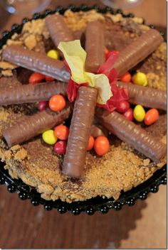 Fire brownies! Bake brownies as usual, but in a round pan. Then, frost with chocolate frosting, cover with crumbled/crushed graham crackes, and finally build the fire with twixes, reeses pieces and possibly some fruit roll-up! How cool would this be at a campfire?!