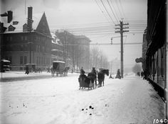 Georgia Street in the snow  VPL Accession Number: 2452  Date: 190-  Photographer/Studio: Timms, Philip  Content: Looking west from the east side of Granville Street (in front of the Hudson's Bay Co.) with the first Hotel Vancouver left, Georgia Pharmacy right (at the Johnston-Howe Building), and Wesley Methodist Church partially visible in the distance (centre-right). Wagons, a streetcar, and horse-drawn sleigh.  http://www3.vpl.ca/spe/histphotos/
