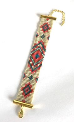 Geometric bracelet, loom bracelet, native style bracelet is 5,75 inch (15,5 cm) long and has extension chain which accommodates to wrist sizes between 5,75 inch - 7,5 inch. Bracelet is hand woven using a bead loom. Fore more items in my shop go to: https://www.etsy.com/shop/AllasArt