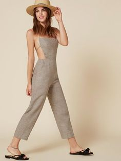 We basically took the Manon Dress, gave it some legs, and bam - this jumpsuit. This is an open back jumpsuit with a halter neck and a relaxed fit.