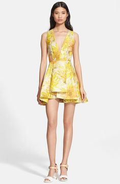 Free shipping and returns on Alice + Olivia 'Tanner' Floral Jacquard Fit & Flare Dress at Nordstrom.com. Brilliant woven flowers dusted in golden shimmer ignite on a daring, yet classically elegant, cocktail dress tailored to perfection with a plunging V-neckline, cutaway back and kicky, deftly pleated skirt.