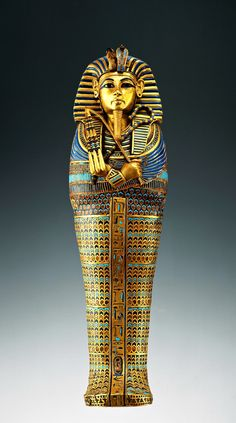 completelyunproductive:  The second coffin of Tutankhamun. (1336-1327 BC) Wood covered with gold foil inlaid with red, blue and turquoise glass. Tutankhamun wearing nemes headdress and holding crook and flail. Cairo, Egyptian Museum