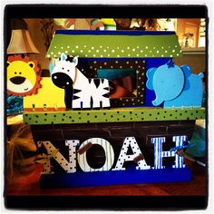 Noah name sign for baby shower. Bought plain wood Ark with animals at Hobby Lobby for $7 and painted it myself. Noah is chipboard letters I painted.