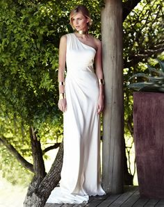 Greek goddess wedding gown - not so hot for the golden dog collar but love the idea of the gown and the arm cuffs